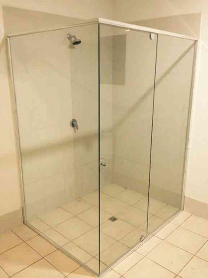 Framed shower screen glass